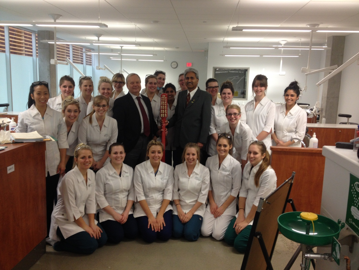 Dr Dhami, Dr. Evered and Dental Assisting students